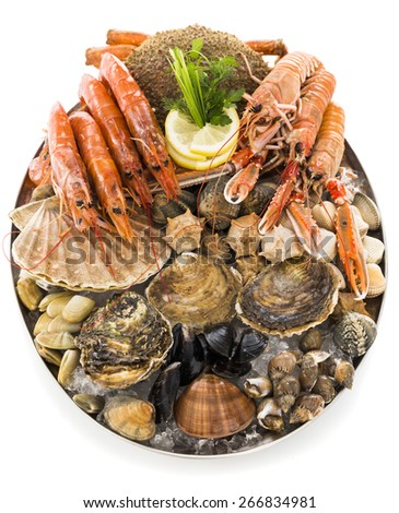 tray with assortment of seafood isolated on white - stock photo