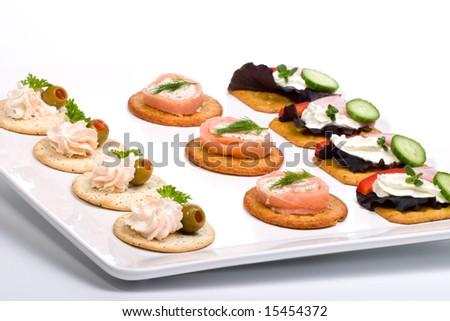 Tray with fresh sandwiches on holiday table - stock photo