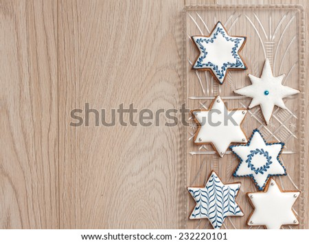 Tray with hand made cookies. Gingerbread biscuits decorated with royal icing in white and blue. Happy Hanukkah! Marry Christmas! - stock photo