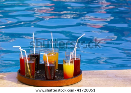 tray with many various drinks on the poolside - stock photo
