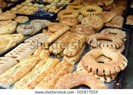 Trays of all kinds of Greek breads and pastries on display at a traditional bakery in Rethymno, Crete