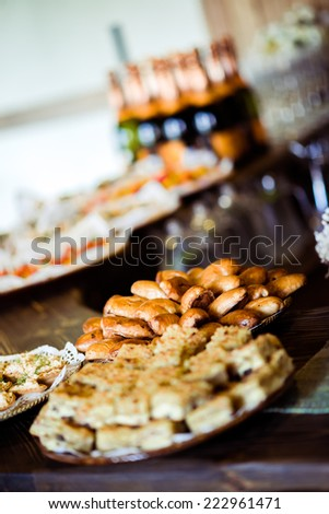 Trays with various appetizers close-up - stock photo