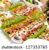 Trays with various delicious appetizer - stock photo