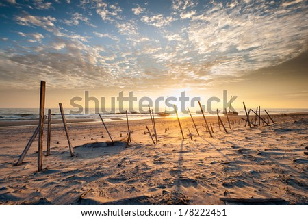 Treacherous Coastline North Carolina Outer Banks Beach Sunrise - stock photo