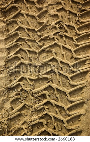 Tread pattern of truck tires in soft, sandy soil - stock photo