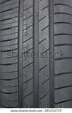 Tread tire for a car close-up. - stock photo