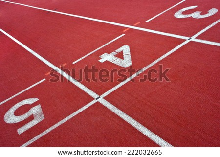 Treadmills with numbers at the stadium for athletics - stock photo
