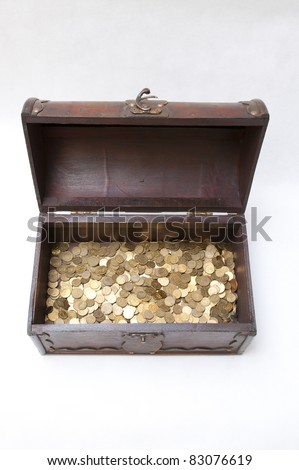 Treasure box with golden coins - stock photo