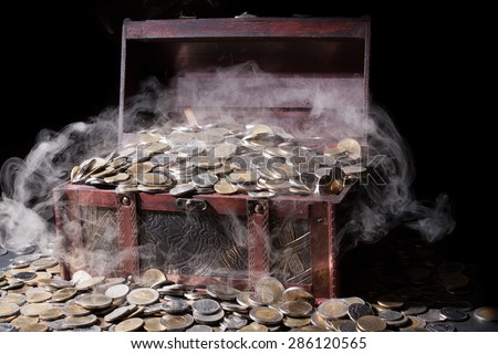 Treasure chest filled with coin baht  and fog. It seems a mystery - stock photo