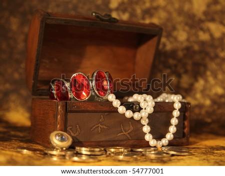 Treasure chest full of jewelry - stock photo