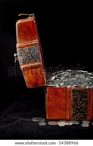 Treasure Chest. Isolated on a black background - stock photo