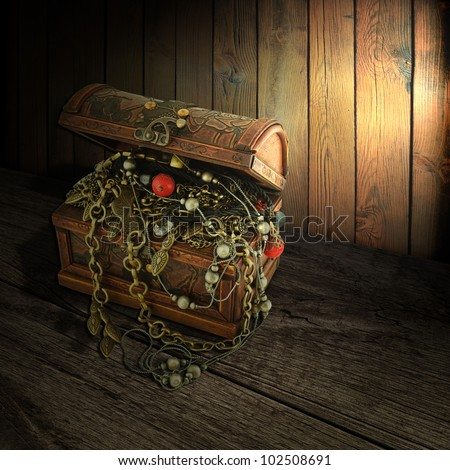 Treasure chest isolated on a wooden table - stock photo