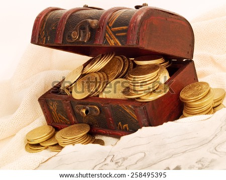 Treasure chest with gold coins and a treasure map