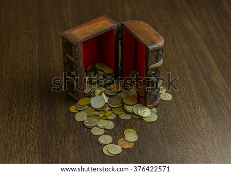 Treasure chest with old russian coin and a wood floor in the background - stock photo
