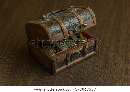 Treasure chest with old russian coin and have a wood floor in the background - stock photo