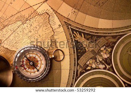 Treasure map and compass navigation instrument - stock photo