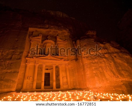 Treasury at Petra Jordan lit by candle under the stars - stock photo