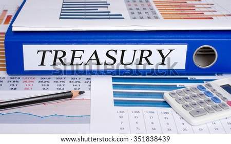 Treasury blue binder in the office with statistics and calculator - stock photo