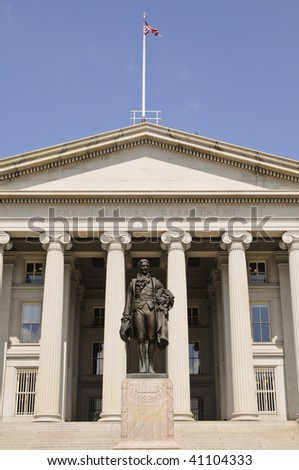 treasury department building in Washington DC with Alexander Hamilton statue - stock photo