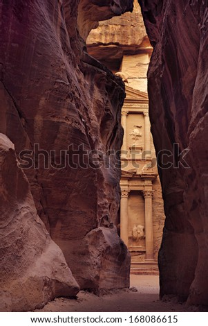 Treasury  in vertical position, picture taken inside of Siq, City of Petra, Jordan - stock photo