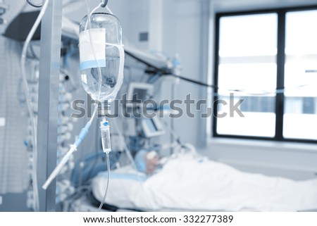 Treatment of a patient in critical condition in the ICU ward - stock photo