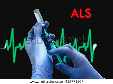 Treatment of ALS (amyotrophic lateral sclerosis). Syringe is filled with injection. Syringe and vaccine. Medical concept. - stock photo
