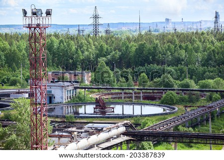 Treatment plant in green woods - stock photo