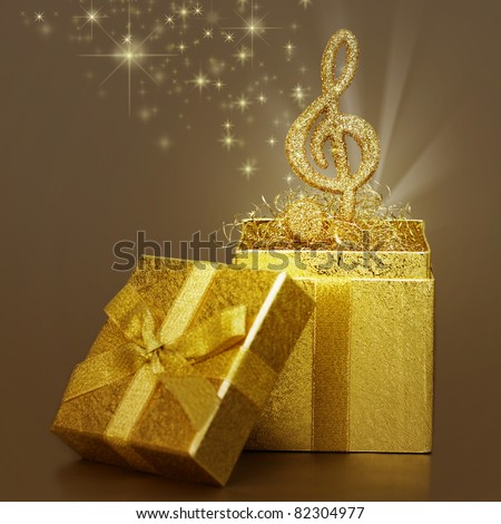 Treble clef as a gift for Christmas - stock photo