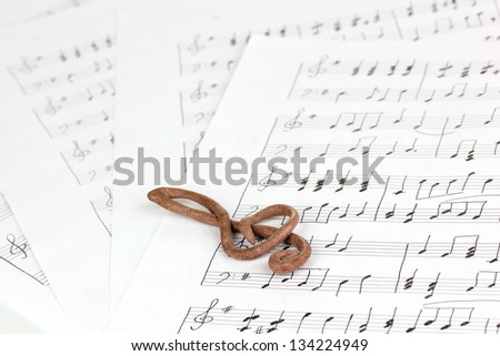 Treble clef on musical background - stock photo