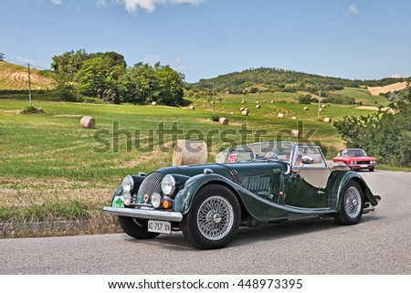 "TREDOZIO, FC, ITALY: driver and co-driver on a vintage car Morgan 2.0 traveling in the hills during the rally ""Colline di Romagna"" on July 3, 2016 in Tredozio, FC, Italy"