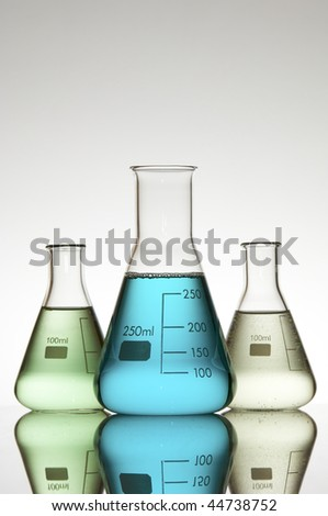 tree beakers with color liquid - stock photo