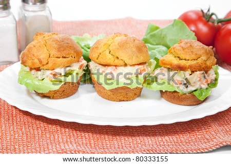 Tree cakes filled with russian salad and  lettuce serve on plate - stock photo