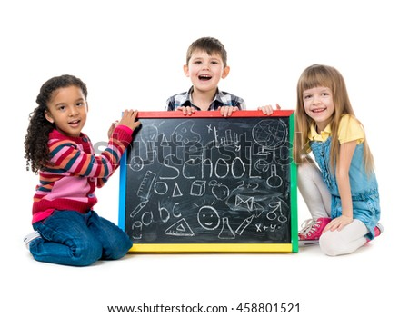 tree cheildren look at little blackboard sitting on the floor isolated on white background