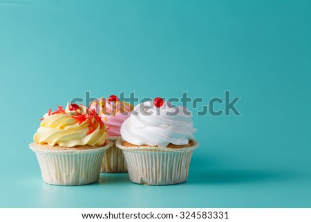 Tree colorful pink cupcake on aquamarine background - stock photo