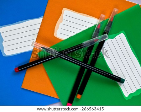 tree colour school writing books and felt-tip pens - stock photo