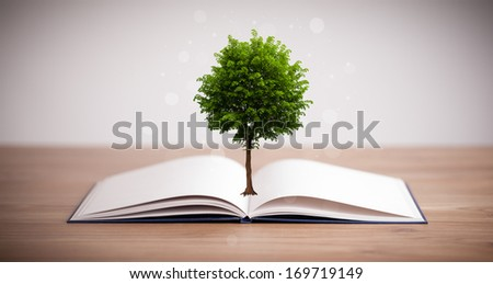 Tree growing from an open book, alternative recycling concept
