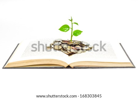 "tree growing from books with coins / A big open book with coins and tree. ""Reading makes you richer"" concept."