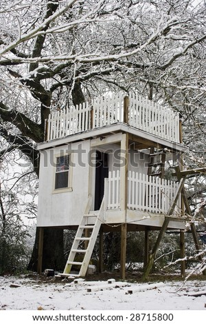 Tree house in the snow - stock photo