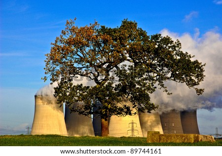 Tree in front of the cooling towers of the Ratcliffe Power Station in England - stock photo