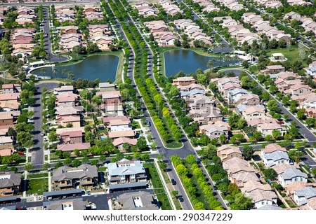 Tree lined streets in suburb with man made lakes in east Mesa, Arizona - stock photo