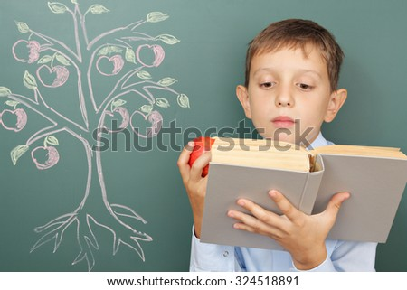 Tree of knowledge education concept with boy reading book