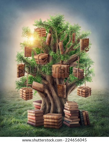 Tree of knowledge in the meadow - stock photo