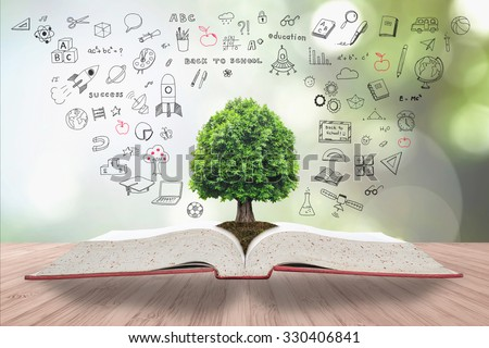 Tree of knowledge/ life growing on soil from big archive open textbook w/ creative freehand doodle drawing on wooden table Blur natural green background Educational arbor growth conceptual csr IP idea - stock photo