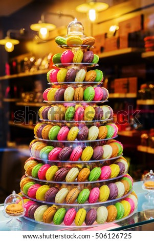 tree of macarons in the window display of a pastry shop