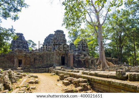 Tree roots growing on Ta Prohm temple (Rajavihara) ruins, Angkor, UNESCO World Heritage Site, Siem Reap Province, Cambodia