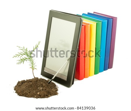 Tree seedling with row of books and electronic book reader behind isolated on white - stock photo