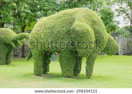 Tree shaped elephant in park - stock photo