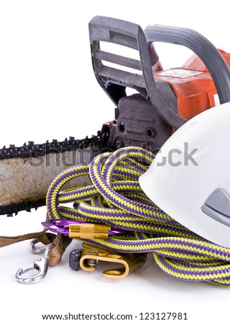 tree surgeon tools including chainsaw, helmet, harness and rope on white portrait - stock photo