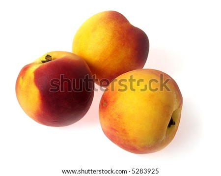 Tree tasty juicy peaches on a white background - stock photo