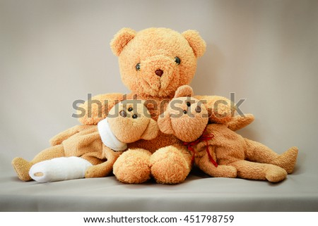 tree teddy bear with bandage on gray background. - stock photo